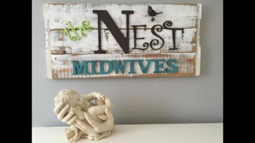 The Nest midwives wooden sign